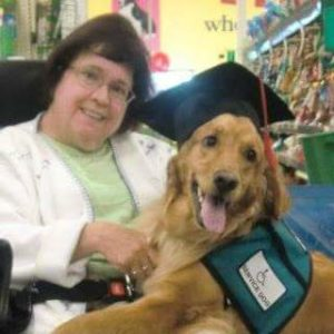Mary Kiddoo and Molly her service dog